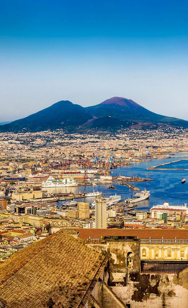 Scenic picture-postcard view of the city of Napoli (Naples) with famous Mount Vesuvius in the background in golden evening light at sunset, Campania, Italy    |  45 Reasons why Italy is One of the most Visited Countries in the World