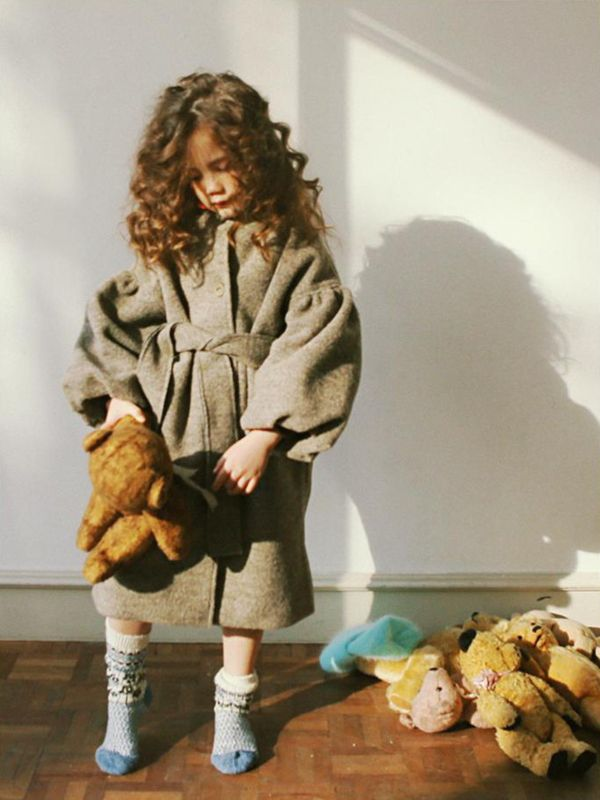 Warm wintercoat in a beautiful dark mocha colour, by South Korean designlabel Tambere. The coat has puffy arms, a belt and no collar.designer: Tamberematerial: 50% wool, 50% polyestercolour: mochasize range: 4 years through to 9 yearscare instructions: