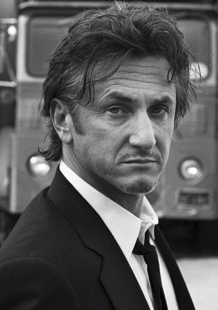 Sean Penn, shaking han...