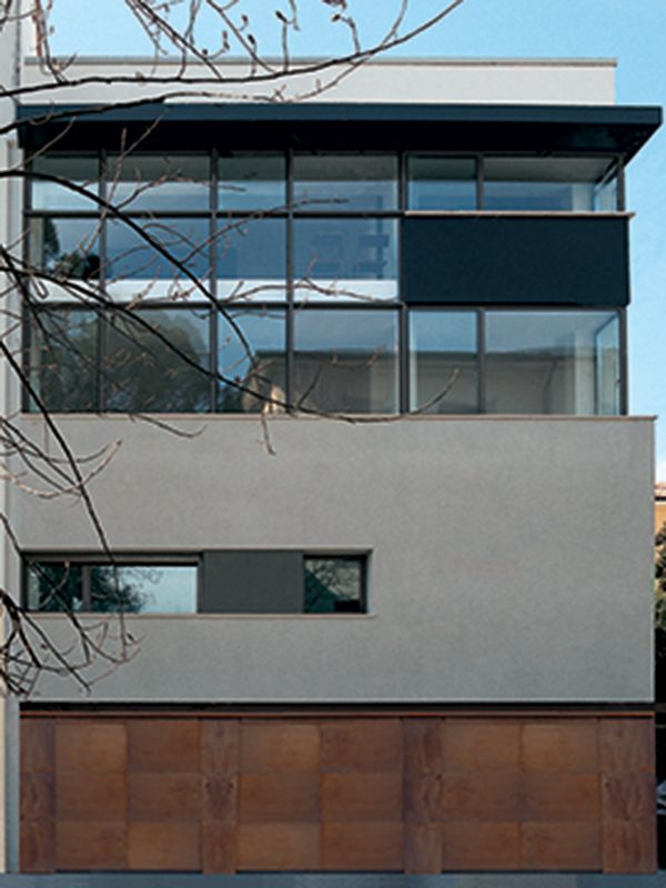 Piavevetro frameless tilt and turn windows integrated into a structural glazing facade