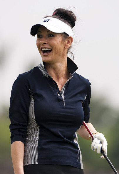 Catherine Zeta-Jones Photos Photos - Oscar-winning actress Catherine Zeta-Jones smiles during the pro-am for the Mission Hills Star Trophy on October 28, 2010 in Haikou, China. The Mission Hills Star Trophy is Asia's leading leisure liflestyle event and features Hollywood celebrities and international golf stars. - Mission Hills Star Trophy - Day 2