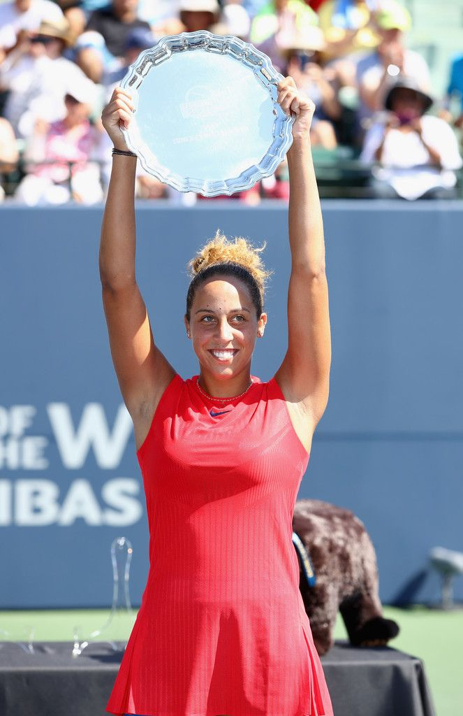 Madison Keys holds up the trophy after beating CoCo Vandeweghe in the finals on Day 7 of the Bank of the West Classic at Stanford University Taube Family Tennis Stadium on August 6, 2017 in Stanford, California.