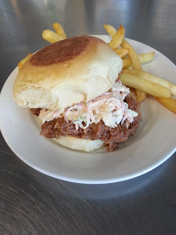 pork slow cooked for 10 hours with hickory smoked bbq sauce and green apple slaw