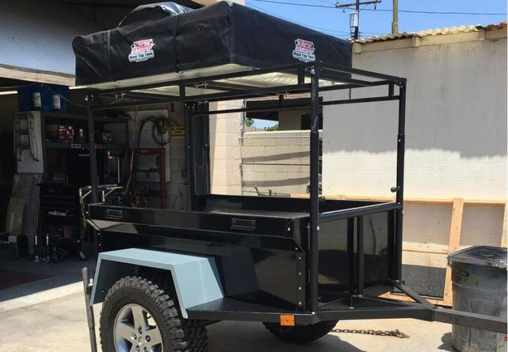 Here is Mark's M-Series M416 trailer telescoping frame tied rack in the up position. An adjustable rack gives you the best of both worlds, lower center of gravity on the trail and tall roof top tent position in camp.