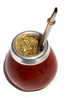 A traditional South American beverage made by steeping the dried leaves of the yerba mate plant in hot water.  Mate is traditionally served in a calabash gourd and sipped through a silver straw (bombilla).  Mate purist never wash their gourd.