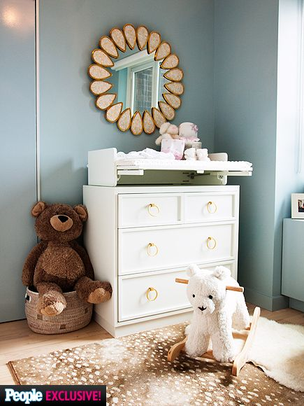 "Go Inside Daphne Oz's Sweet & Sophisticated Nursery | ZOO CHIC | To incorporate Oz's love for animal decor, they added everything from an antelope rug to stuffed bears in lush shades of brown to complement her white Bellini changing table and dresser. ""On the one hand, it's so rustic, but it's also beautiful. We live in the city – you're not going to see an antelope running around."" The metal teardrop Jonathan Adler mirror is also a favorite. ""When I saw it I was like, 'This has to happen!'""…"