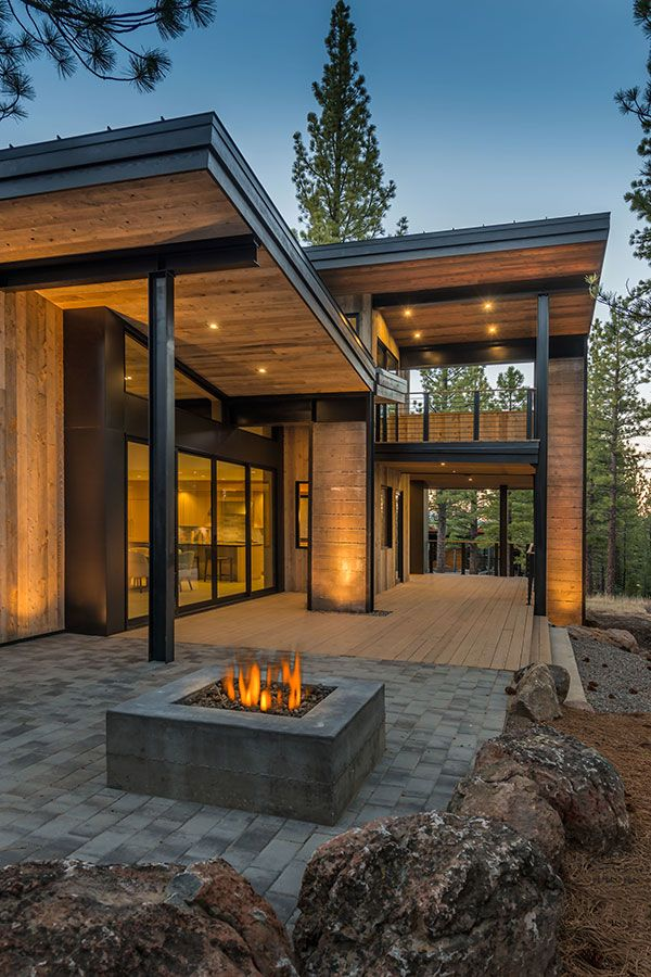 Mountain retreat blends rustic modern styling in martis for Mountain modern architecture