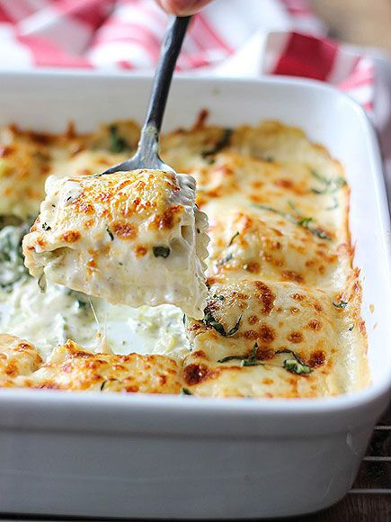 15 Recipes That Prove Casseroles Are Actually Awesome | SPINACH-ARICHOKE RAVIOLI | Basically hot spinach-artichoke dip layered with cheese-filled pasta. Need. Now. Get the recipe HERE.