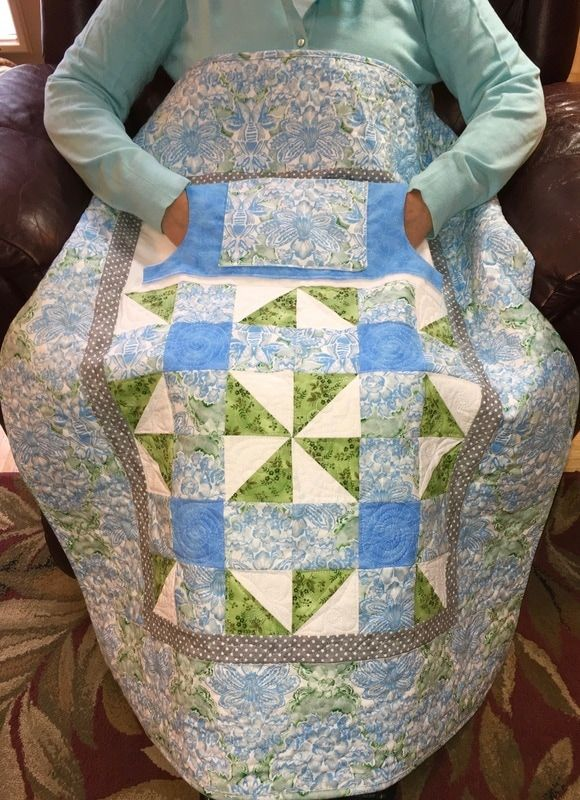 Lovie Lap Quilt with Pockets to keep your hands warm from http://www.HomeSewnByCarolyn.com