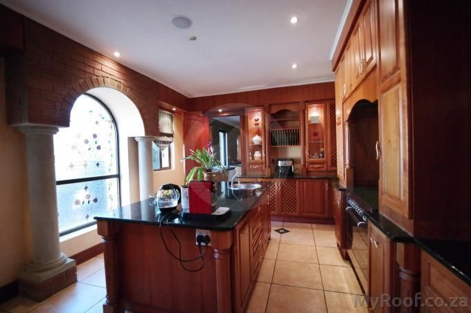 Solid wood cabinetry raised ceilings with Romanesque cornices in Exclusive Estate Homes found on MyRoof.co.za