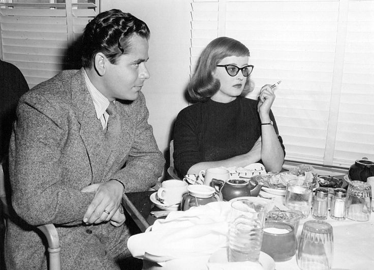 Glenn Ford and Bette Davis have lunch during filming of A Stolen Life Tags: 1946, A Stolen Life (1946), Bette Davis, break, cigarette, Glenn Ford, lunch, Take a Break,