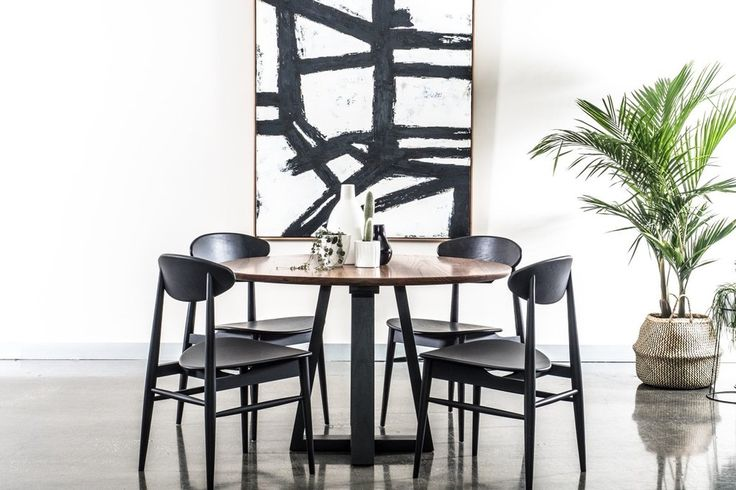 Create drama in your dining room with the Vista round dining table with a black base.  Couple it with black lotus chairs and the monochrome Maddox canvas art to complete the look. Available from urbanrhythm.com.au