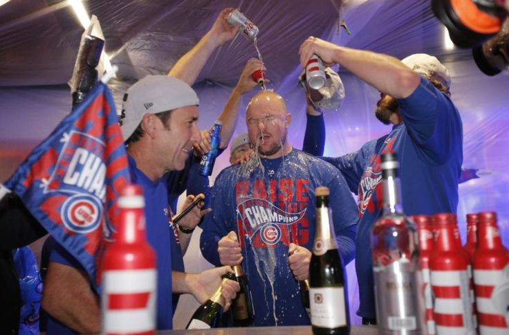 Oct 22, 2016; Chicago, IL, USA; Chicago Cubs starting pitcher Jon Lester gets beer poured on his head in the clubhouse after defeating the Los Angeles Dodgers in game six of the 2016 NLCS playoff baseball series at Wrigley Field. Mandatory Credit: Jon Durr-USA TODAY Sports