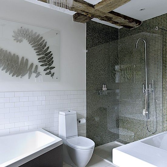 green tiled shower - marks it as separate area in bathroom.  love the leaf wall art