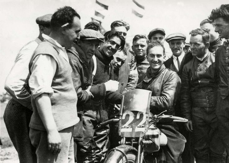 Dutch GP TT, Assen, 1928. Martinelli (with injured hand) wishes Woods the best of luck for the race.