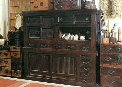 How about this instead of the usual kitchen hutch?  The mizuya tansu, or kitchen chest makes the kitchen space beautiful & unusual.