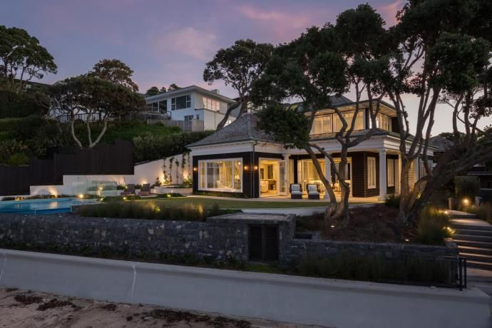 Upmarket coastal home evokes classic Cape Cod style features, an article at…