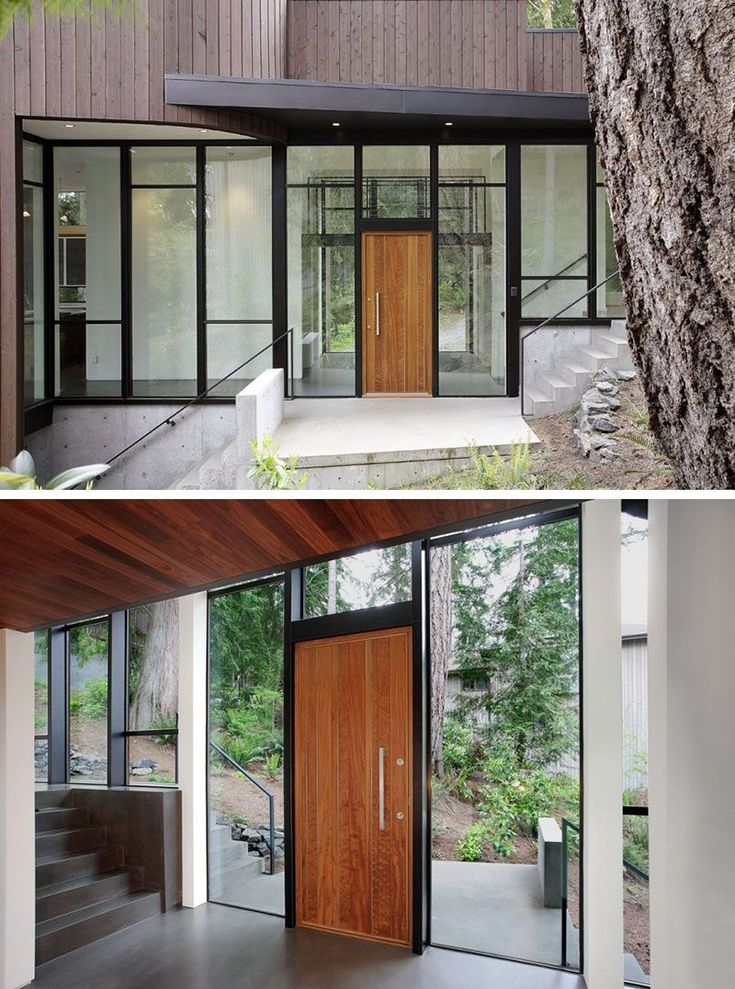This light wood paneled door, featuring a silver door handle, is surrounded by a wall of windows and black steel frames that create a modern entryway full of natural light.