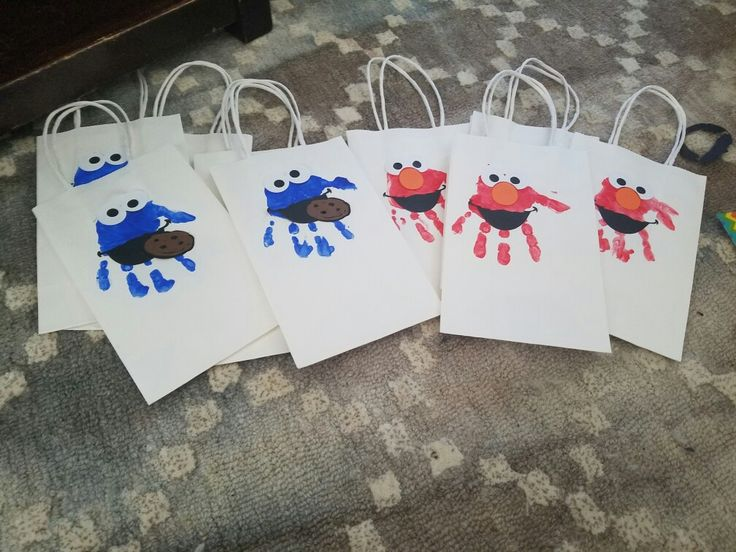 Thank you bags with birthday childs handprint! Added details to make Sesame Street characters
