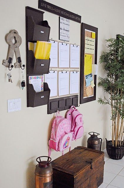 Wall Organization. LLLLOOOOVEEE this and so want to do something similar.  I'm not sure what I would put on all the clipboards, maybe to do lists, chore charts for the kids, what else???