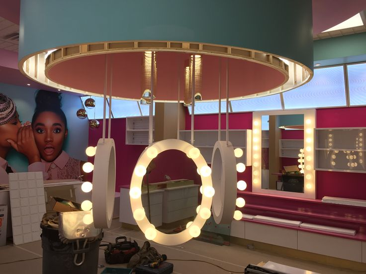 Custom cosmetics mirrors with light bulbs made by Tazz lighting, designer Mindful Design Consulting. Beauty Bakerie store interior in Mission Valley Mall San Diego CA.