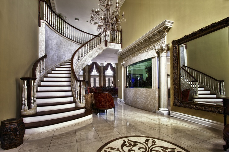 Grandeur Foyer featuring all porcelain tiles with an inlaid medallion and a 700 gallon fish tank. For more information on this home please visit http://statenislandlifestyle.com/listings/4-5-bedroom-8-baths-custom-lux-staten-island-new-york/