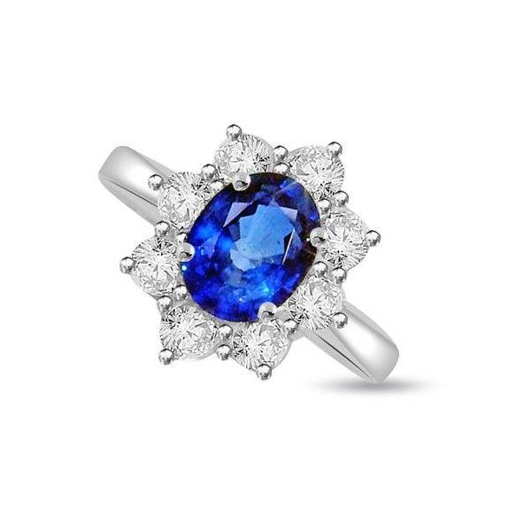 ANELLO CLUSTER CON DIAMANTE 18CT ORO BIANCO | Anello Cluster montato in 18ct oro bianco. Lo zaffiro taglio ovale misura 8 x 6mm e gli 8 diamanti circostanti taglio brillante sono a totale peso carati di 0.56ct. Lo zaffiro e i diamanti sono montati in un incastonaturta a griffe. I diamanti sono F, G, H ed I colore e VS1 e SI1 purezza. L`anello e` accompagnato dal certificato del diamante.