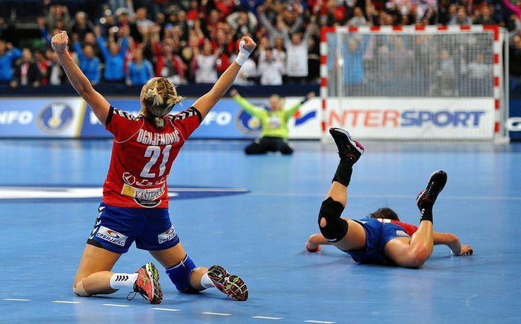 Serbia's Svetlana Ognjenovic (L) celebrates her team victory over South Korea at the end of the 2013 Women's Handball World Championship round of sixteen match between South Korea and Serbia in Belgrade on December 16, 2013. ANDREJ ISAKOVIC/AFP/Getty Images