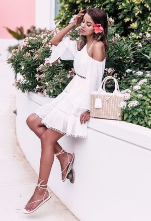 The outfit of jazminbin includes white gladiators of the brand Sandals, beige bags of Prada, and white Dresses's dresses