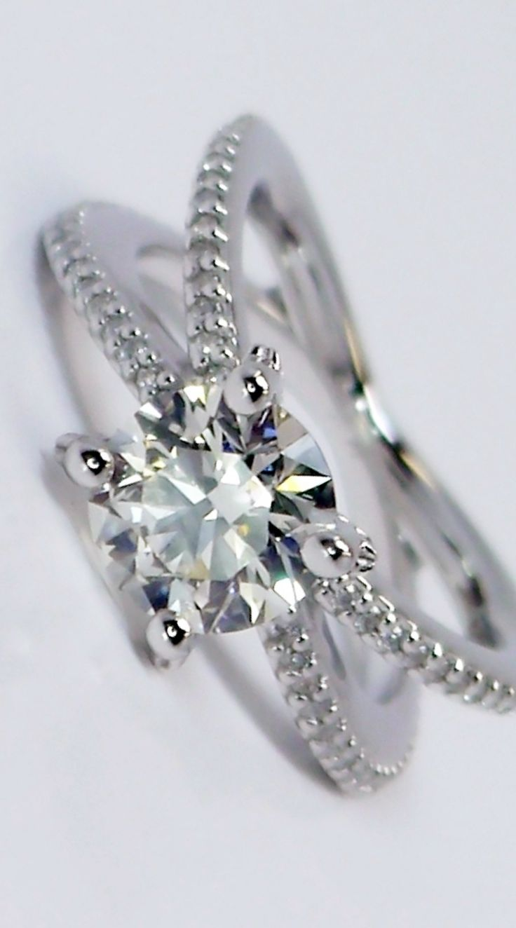 Meet the stylish Cross Split Shank Diamond Solitaire Engagement Ring... an exceptional surprise for your beloved!
