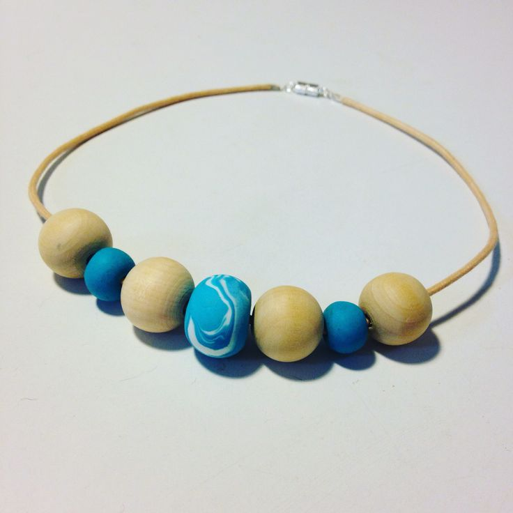 I mixed handmade marbled fimo beads with wooden beads, to make a necklace