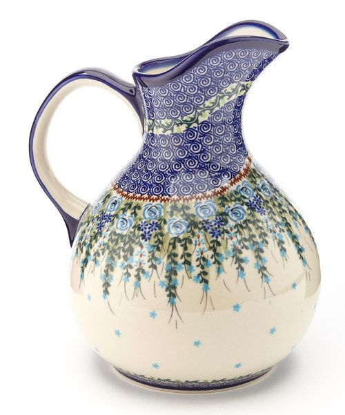 Love the design..Durable, beautiful and functional, this heirloom-quality pitcher is handmade and hand-painted in Poland with traditional designs, so it's guaranteed to be stunningly unique. It's perfect for lemon water or sweet tea, and the slick glaze ensures easy cleanup.  9'' H x 7'' diameterEarthenwareDishwasher and microwave safeMade in Poland