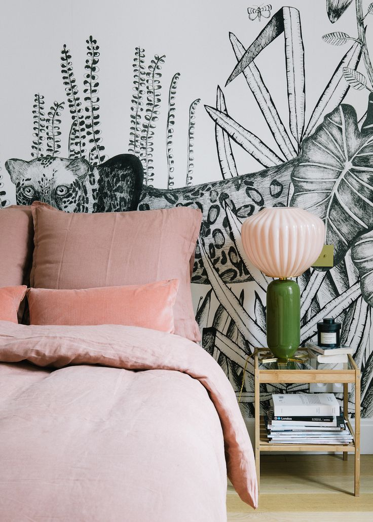 Morgane Sezalory's Paris Apartment Bedding: Sézane. Palm wallpaper: Bien Fait. Pink lamp: India Mahdavi. Green velvet chair: vintage.