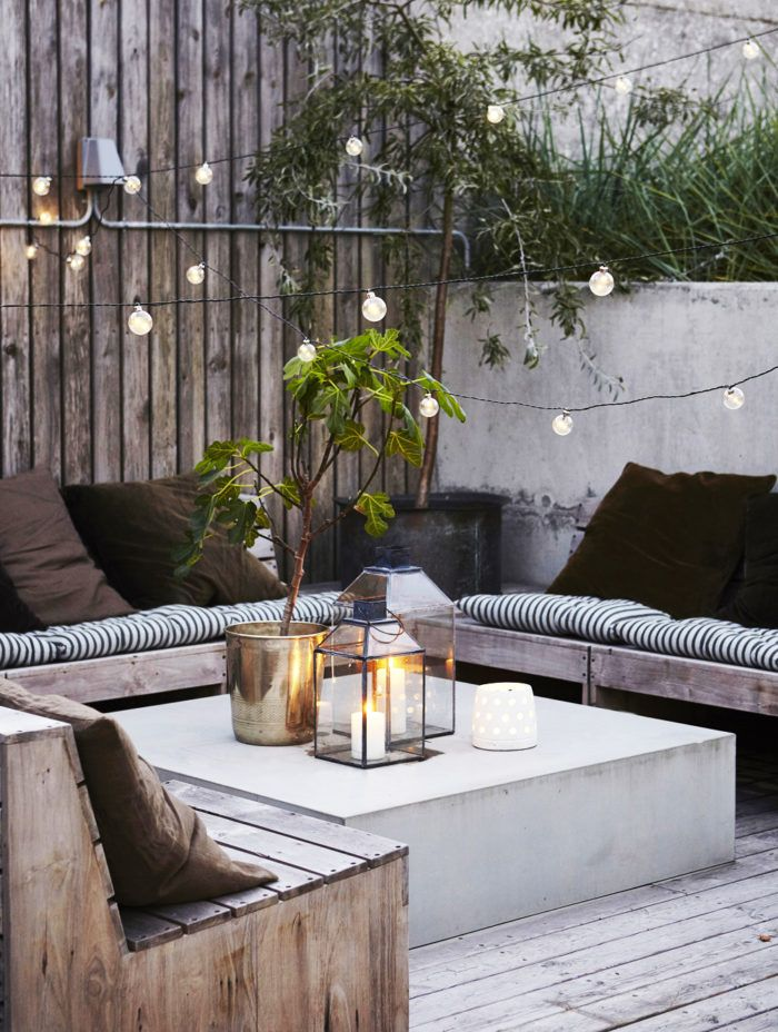 Conduit as decorative element. Weathered wood. High planters/fence and barrier. Suspended lights. Pallet-like seating