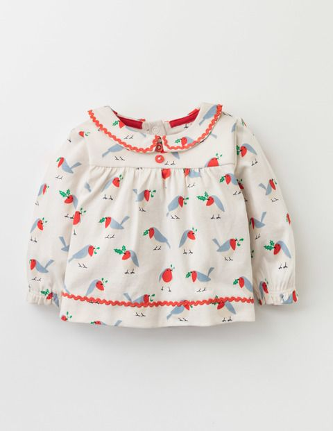 Our supersoft jersey tee is made of sugar and spice and everything nice. A loose swing fit gives tiny legs and arms plenty of wriggle room, while its Peter Pan collar and dainty buttons look oh-so sweet. And it's practical, too – poppers down the back help make changing times a doddle.