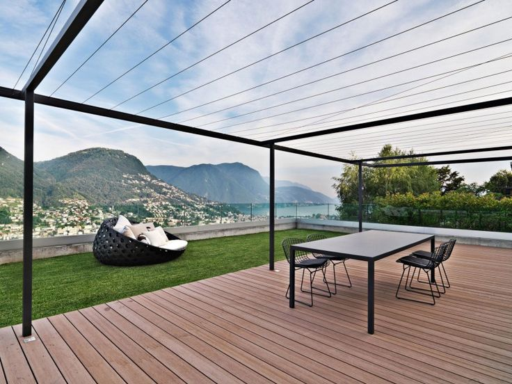 Sleek Attico Migani for a Simple Style : Black Metal Pergola Lovely Mountain View Black Dining Table Wooden Deck