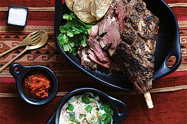 Slow-Roasted Middle Eastern-style-Lamb Leg recipe, Listener – Beautifully slow-roasted lamb is a delight to share with dinner guests. The harissa is good to spread on the flat bread to moisten it or to ­drizzle over the lamb for some extra flavour and it keeps well in the refrigerator. – foodhub.co.nz
