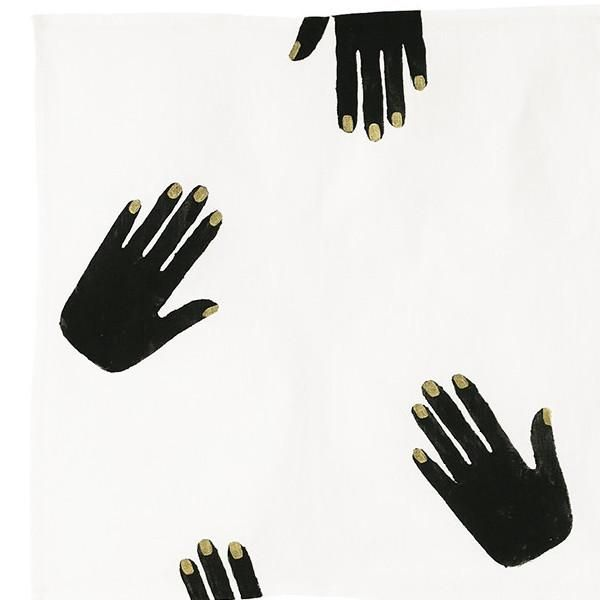 off-white linen napkin printed with black hands with gold nails