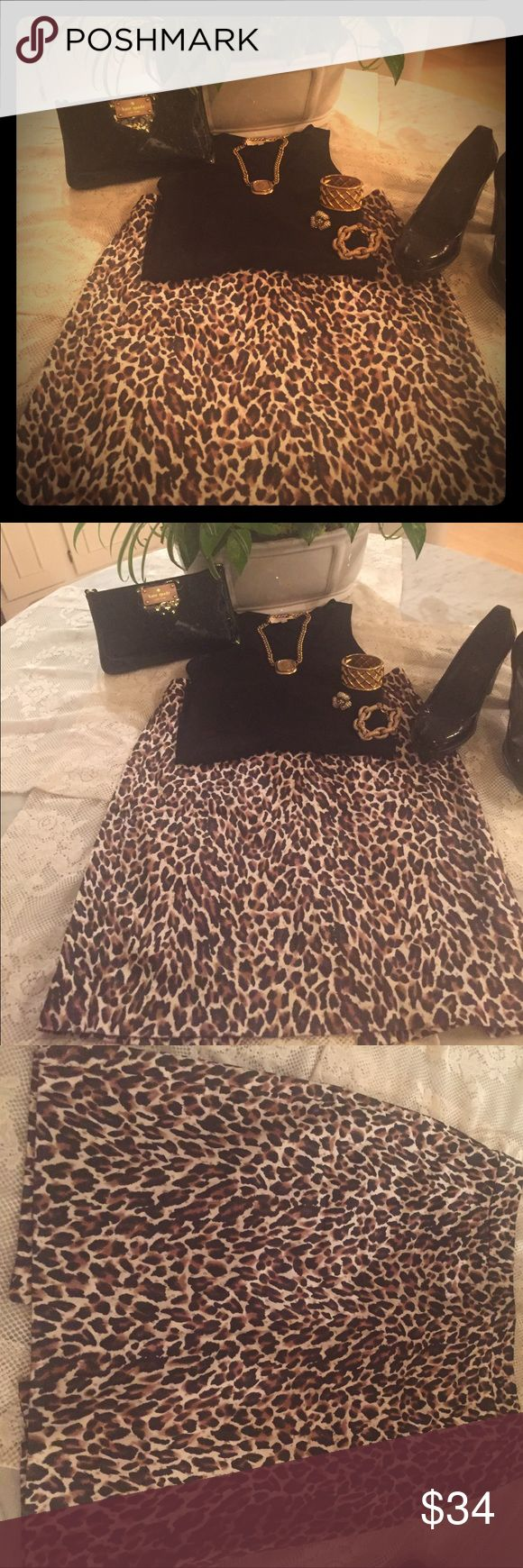J.Crew Leopard SEXY Leopard Pencil Skirt Perfect cotton size 8 Jew Crew Leopard Skirt! Wear all year round! Slit in the back w slight tear which has been sewn. Hard to notice, but FYI! I love this skirt, but just too big for me:) J. Crew Skirts Midi