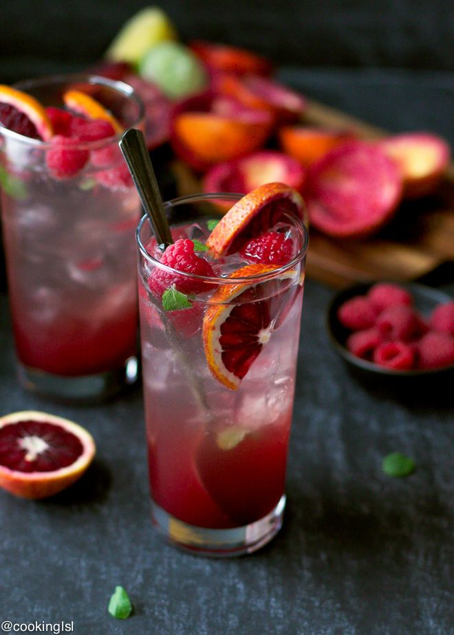 """Blood Orange And Raspberry Mojito Recipe – tartly sweet, simple to make cocktail,that tastes delicious. Hey guys! Happy Monday! How was your weekend? It felt too short for me! I'm not happy with losing an hour but this way I'll have more daylight to take my blog photos. Did I say """"mojito""""? Oh, yeah, I …"""
