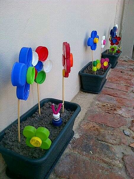 Recycled bottle top flower pots