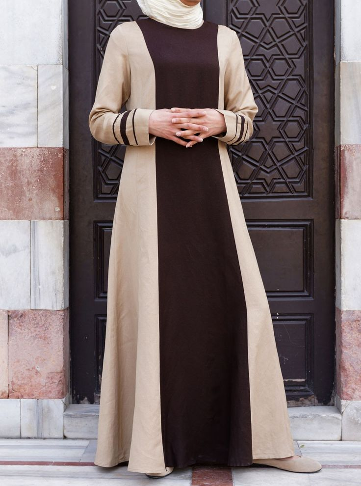 The Khalida Dress is an Islamic fashion classic if ever there was one. This uniquely designed SHUKR dress is a marriage between high class, modern fashion with its long sleek lines and contrasting color, and understated Islamic modesty. This one won't last long, catch yours now before it's gone!