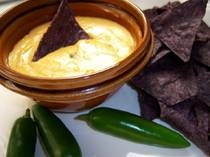 Nacho Cheese Dip - This cheesy, spicy gluten free nacho cheese dip recipe is thickened with amaranth, unlike many store brands which are thickened with gluten.