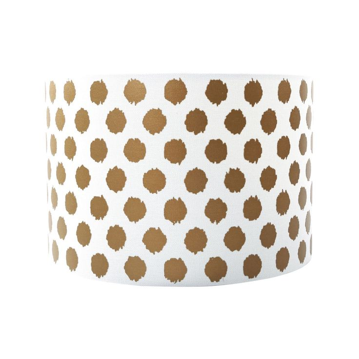 This shade is a contemporary lighting accessory for lending a bold finish to interiors. Ideal for creating a warm glowing ambience in the bedroom or living room, its simple yet stylish curved design is finished in white with a bold spotted pattern.