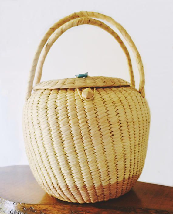 Check out this item in my Etsy shop https://www.etsy.com/ca/listing/545365786/vintage-xhauga-weaver-hand-made-basket