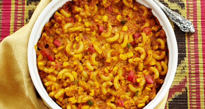 """Macaroni and """"cheese"""" gets a kick with corn, peppers, black beans, and spices. From Forks Over Knives – The Cookbook Instructions: Preheat the oven to 350° F. Place the onion and red pepper in a large saucepan and sauté over...  Read more"""