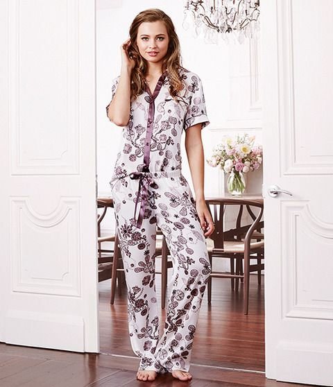 Gabrielle was our queen's closest friend and confidant, a woman she trusted and dearly loved.  This elegant set offers an exclusive jewel print in royal aubergine tones. The soft cotton fabric creates a subtle summer feel and radiates comfort. Satin ribbon borders the centre of the top and also ties at the waist to add a touch of shine and easy adjustment. You can always trust in feeling relaxed and elegant in Gabrielle.