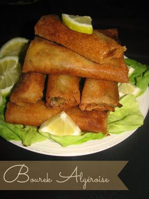 Bourek.... Meat, olive and cheese filled pastry rolls, deep fried and serve with Chorba... Heaven!