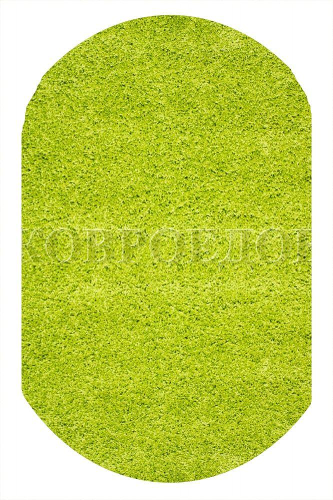 Пушистый ковер зеленого цвета - можно положить на балкон. Он будет играть роль травы