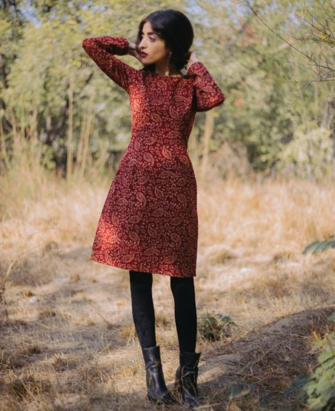 """This rosewood red and cream floral pencil dress is crafted from hand block printed pure cotton fabric and is 34-35"""" long.The dress has a round neck in the front"""
